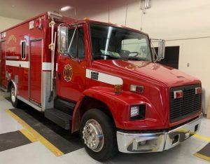 red fire truck in garage