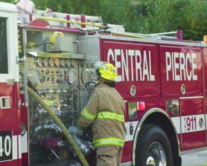 fireman in training outside of firetruck