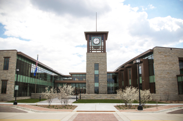 oak creek civic center building with tower and clock
