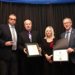 Ken Saunders (left) accepting his award from Mayor Andy Prokop, Angela representing Minister Hunter and Reeve Harris