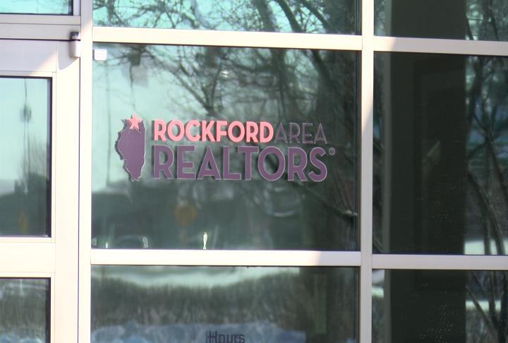 realtor logo on window