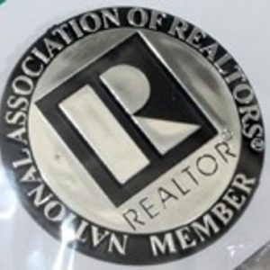silver pin with R in middle