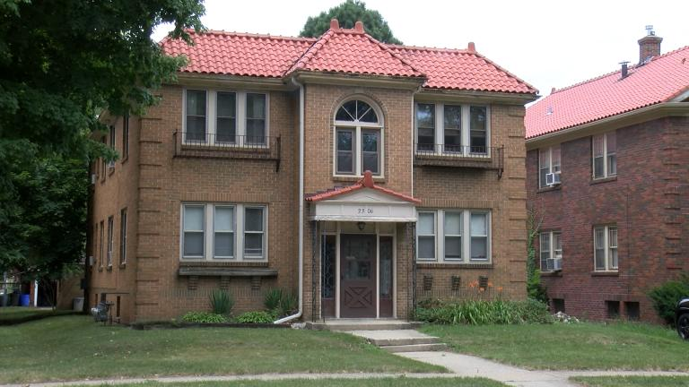 brick two story home. red roof