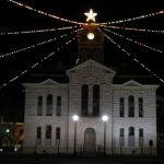 lampasas county courthouse with christmas lights above building and large star at top