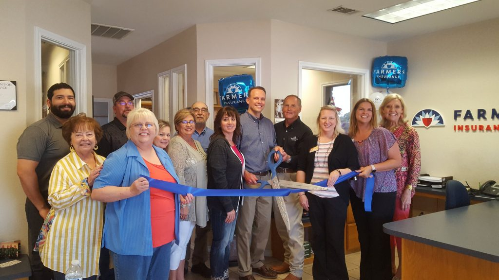 employees and ambassadors at ribbon cutting event at farmers insurance