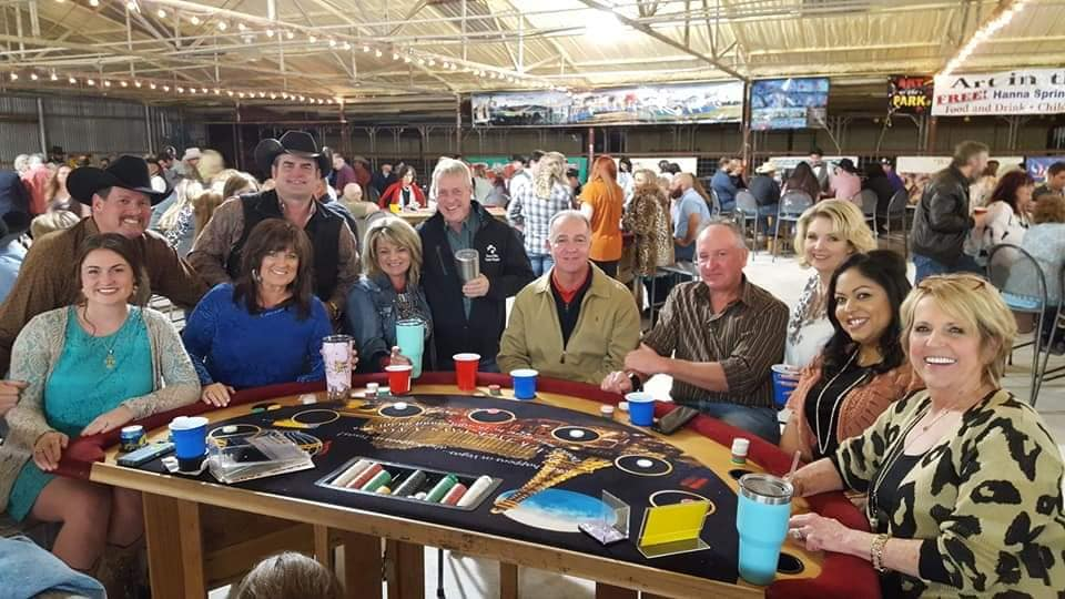 people around blackjack table at casino night event