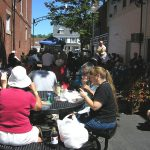 People eating in an Alley