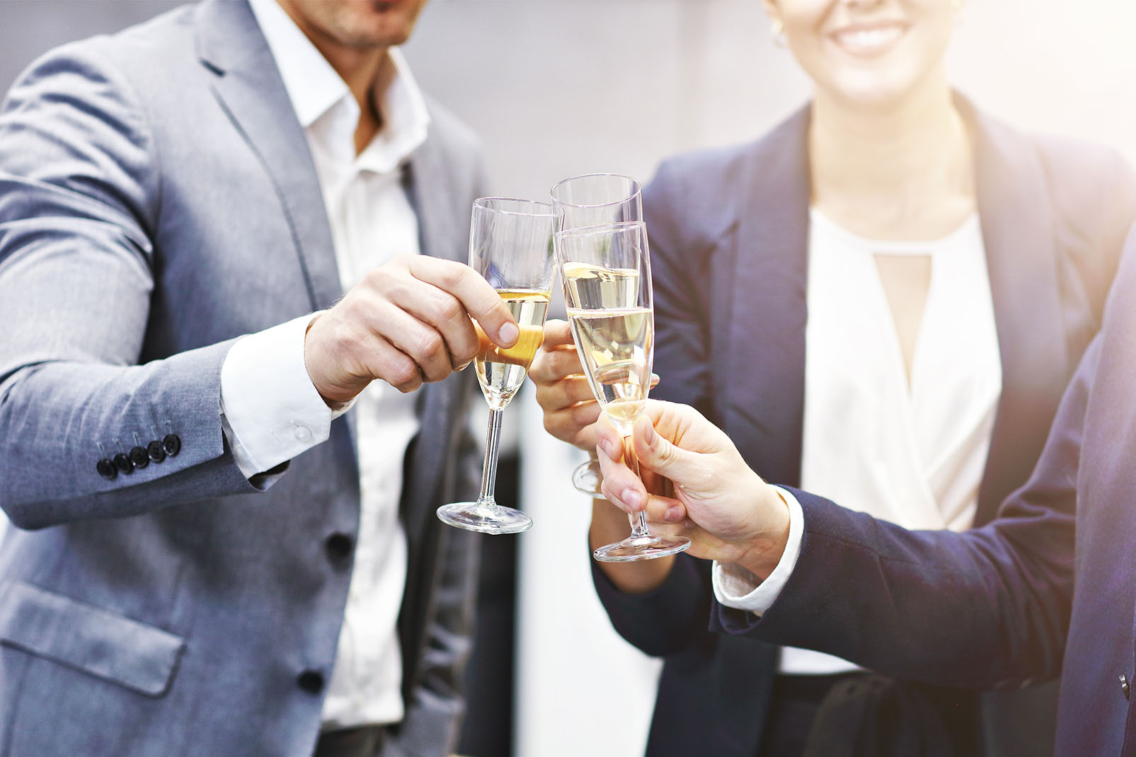 Group of business people celebrating success in modern office