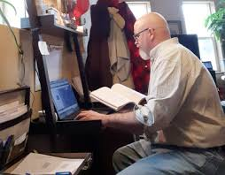 Man taking class by computer