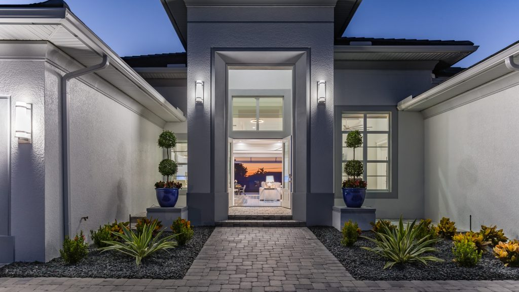 Web SWFL DreamHomes Cover Home Entrance evening