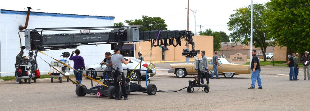 A photo of a camera crane on the set of a production in Clovis, New Mexico