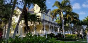 AC Freeman House Yellow Victorian two story in Historic Downtown Punta Gorda