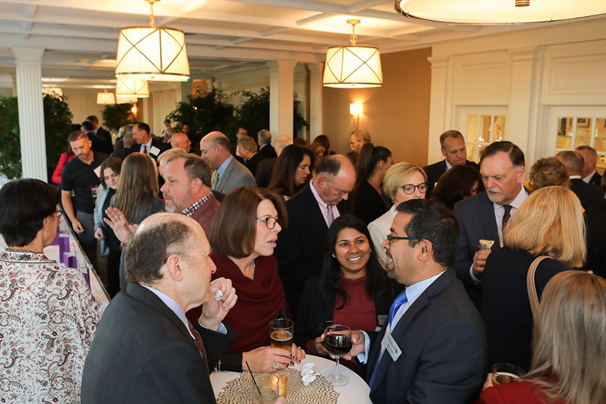 Over 140 attendees enjoy the networking cocktail hour at the 2019 EMCCC Annual Banquet.