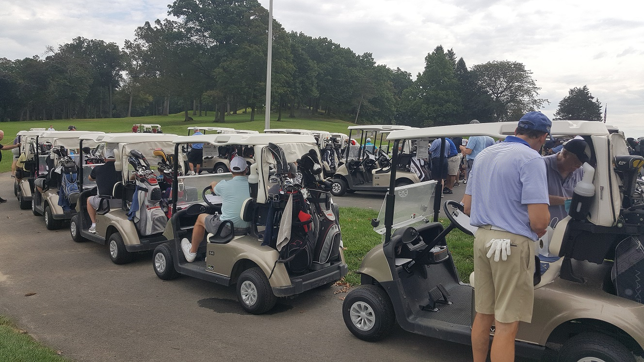 Golfers all lined up in carts to begin the shotgun start of the first Annual EMCCC golf outing.
