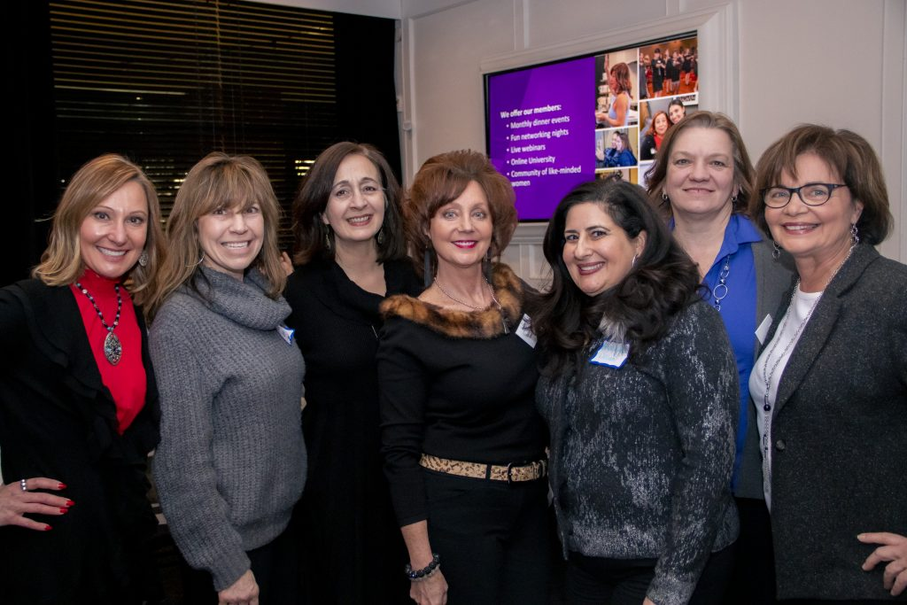 The SheCAN! Network women gathering at an event about us