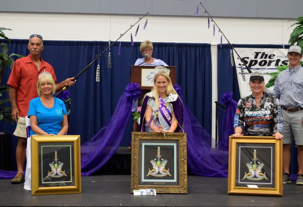 ladies kingfish tournament winners on stage