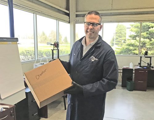 Jeff Robinson with box of face shields for PPE