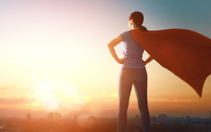 Woman superhero in power pose for Women Inspiring Women article
