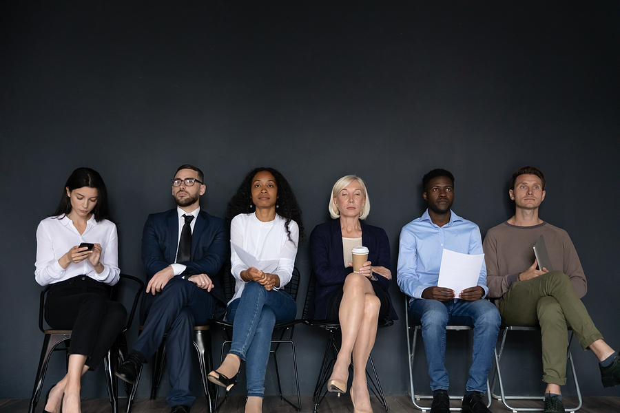Confident Diverse Business People Sitting On Chairs In Row