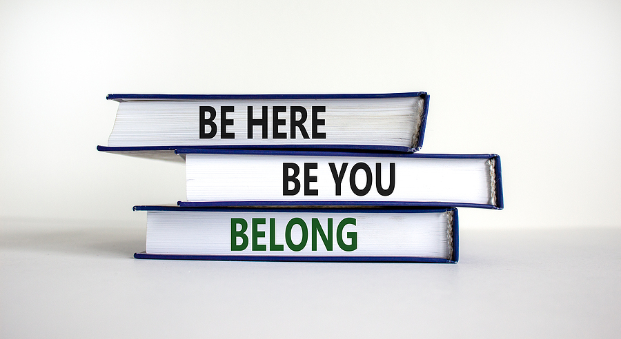 Books With Words 'be Here, Be You, Belong' On Bea