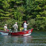 Three men fishing in a boat