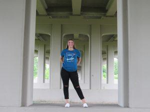 Gitl standing under bridge