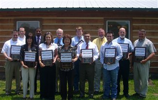 group of people holding plaques