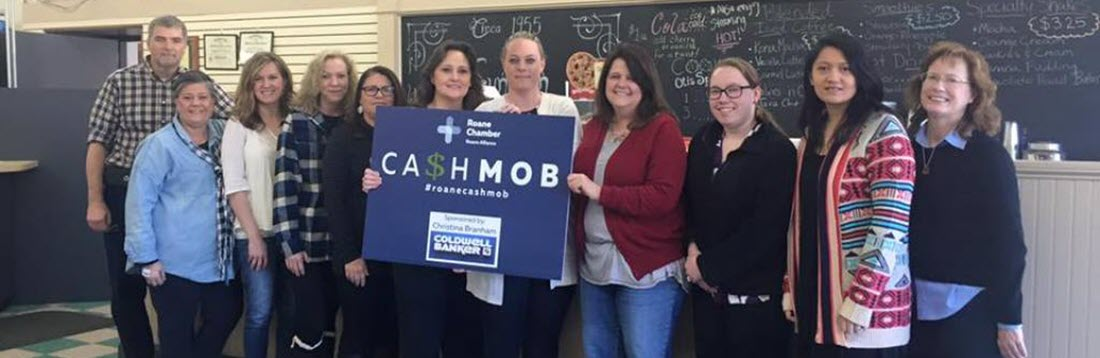 Cash Mob ribbon cutting