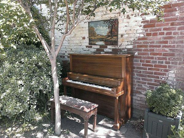 piano and brick wall