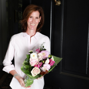 The Flower Bar - woman holding bouquet