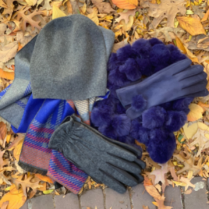 Mancino gloves, hats, scarves on leaves