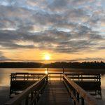 dock in lake at sunset