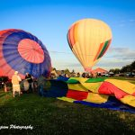 Photos of hot air balloons being deflated after the Galt Balloon Festival