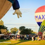 Photo of people and hot air balloons at the Galt Balloon Festival