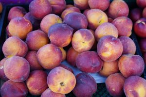 Photos of fresh peaches for sale at the Galt Farmers Market