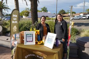 Photo of staff at front table for Galt Farmers Market