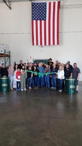 Photo of Frontier Performance Lubrication staff at ribbon cutting