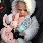 Penelope with her stuffed bunny at Eggstravaganza