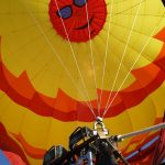Looking up into an inflated hot air balloon, sunshine picture at the Galt Balloon Festival