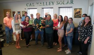 Photo of Cal Valley Solar staff & guests at Ribbon Cutting