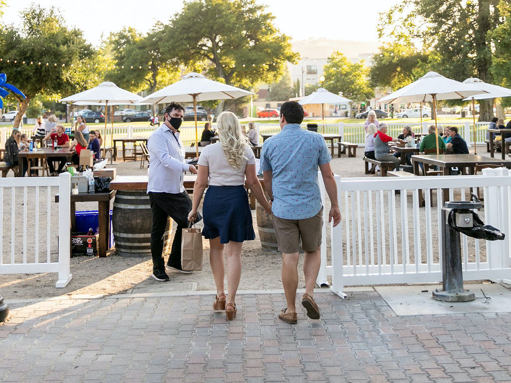 couple walking into park dining area