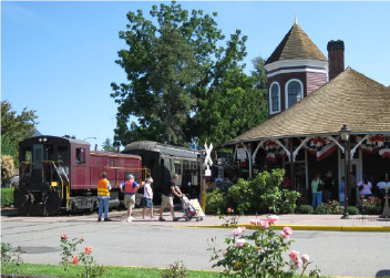 historic depot exterior with train on tracks