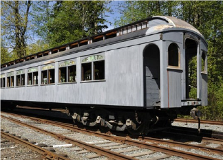 historic railway car on tracks