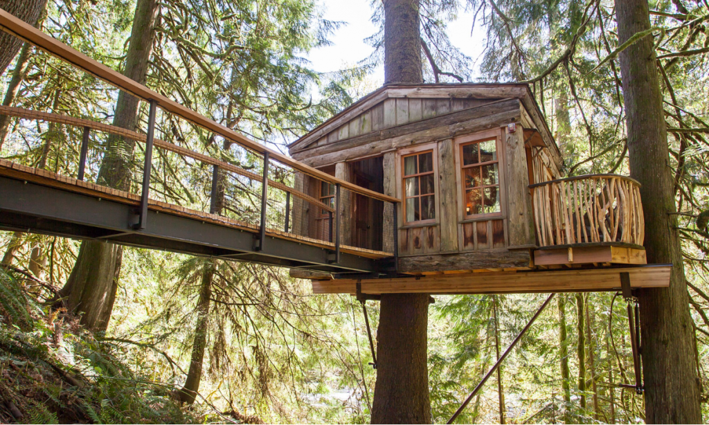 beautiful custom built tree house in the woods