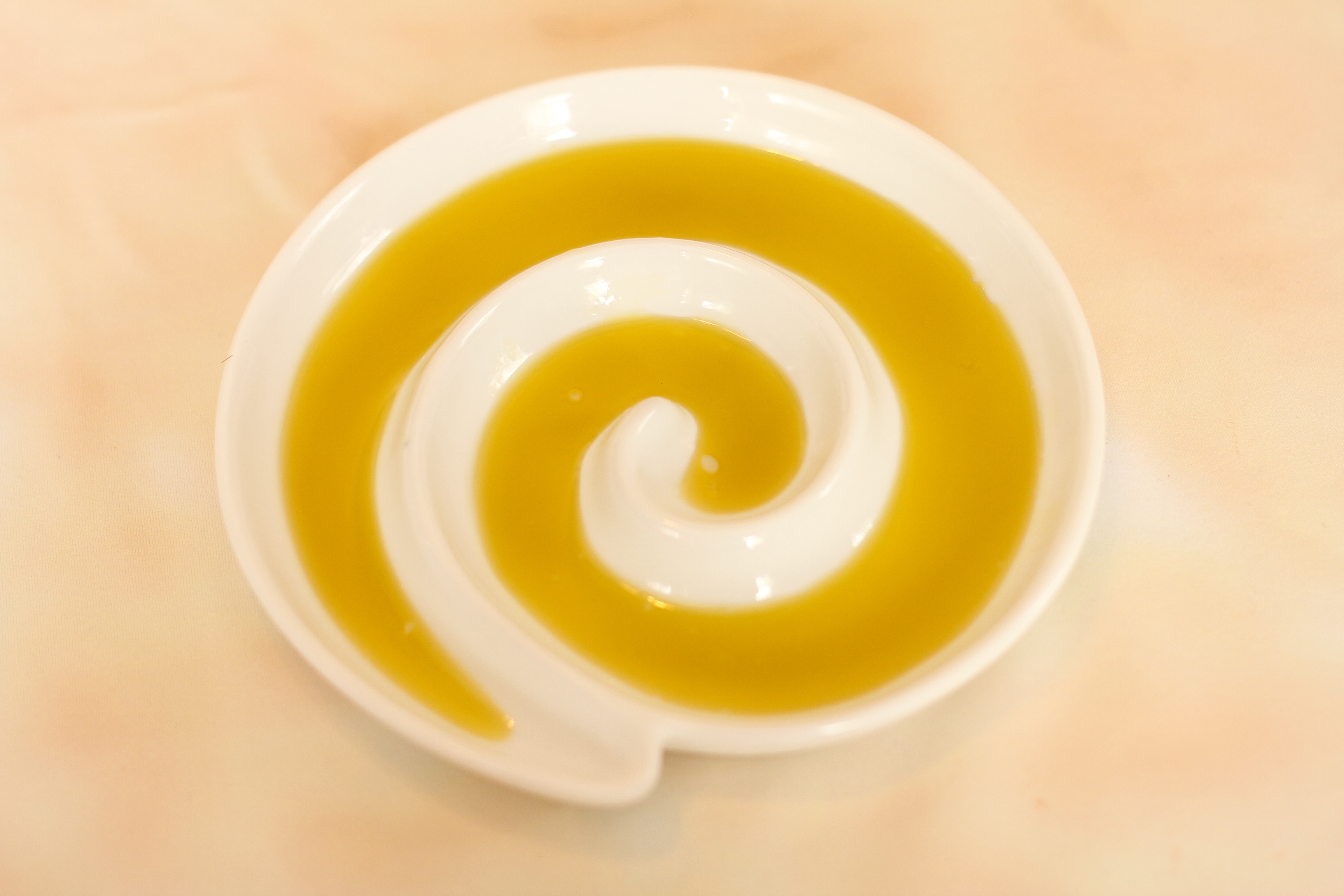 oil in swirl dish