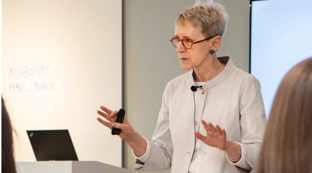 Presenter speaks to attendees during a seminar