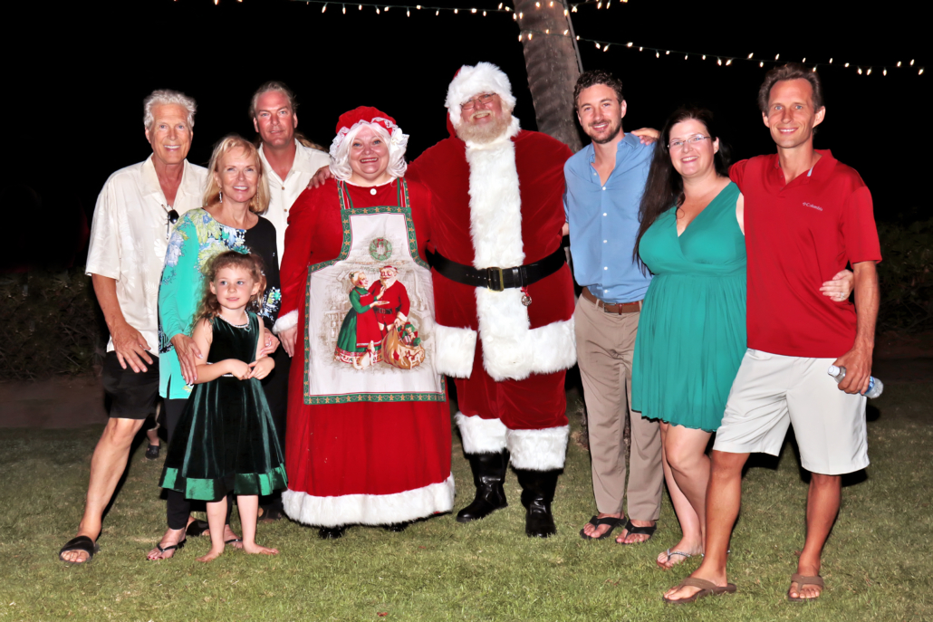 Every year, RAM members Bob and Donna Hansen (far left) and their son, Clint (third from right), bring holiday cheer to kids who need it most. The family's annual toy drive collects Christmas gifts for the Friends of the Children's Justice Center of Maui, a nonprofit that helps children recover from the damaging effects of abuse and neglect. Photo credit: Mary Sloan