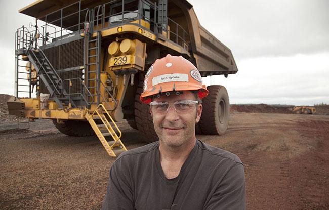 Man standing in front of heavy equipment