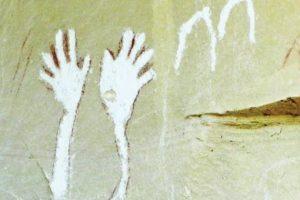 waving hands rock art