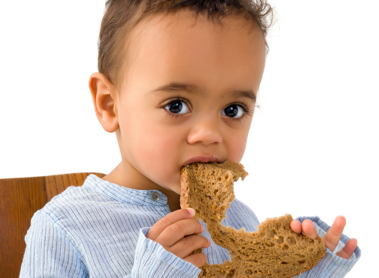 toddler with bread